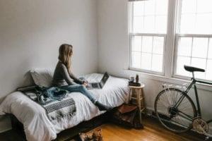 Woman Working on Bed Perri Kersh Pandemic Productivity Advice Blog
